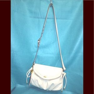 Juicy Couture's 100% PVC bag w polyester lining